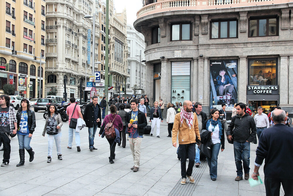 MADRID, SPAIN - People shop downtown in Madrid. Madrid is a popular tourism destinations with 3.9 million estimated annual visitors (official data).