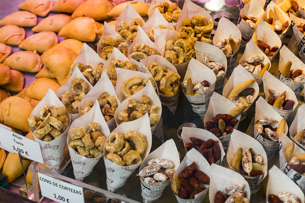 MADRID, SPAIN - The tourist attraction of the city market is San Miguel counters with popular Spanish food.