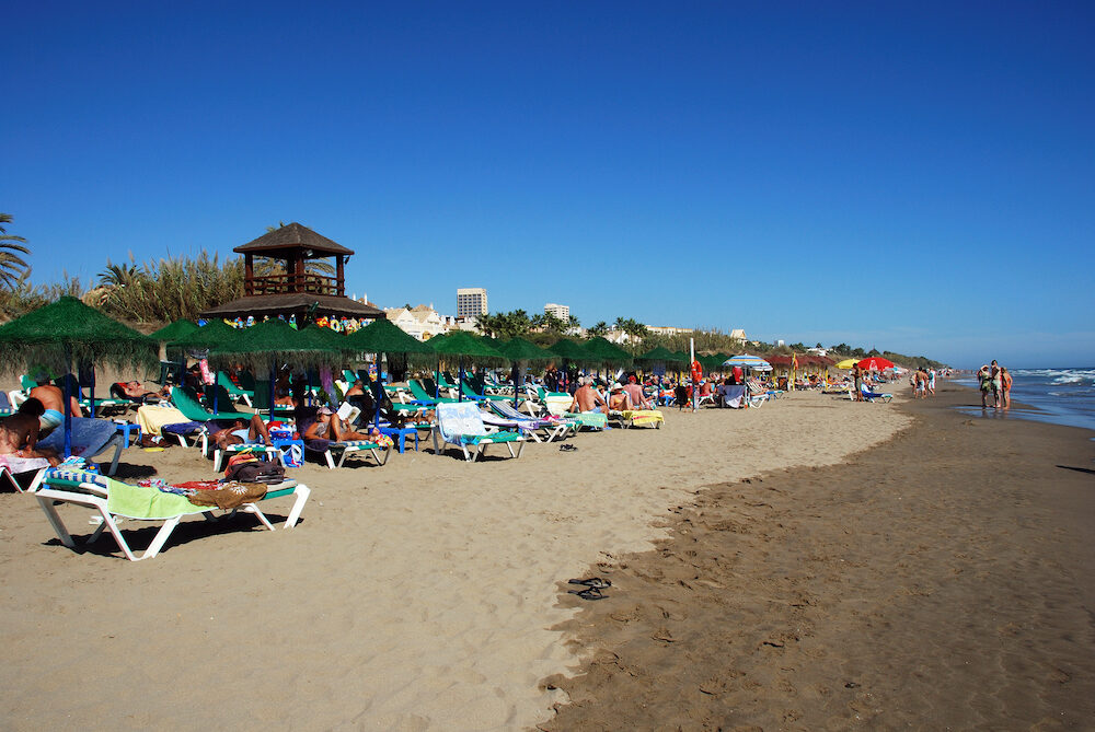 MARBELLA, SPAIN - Tourists relaxing on Playa de la Vibora beach Elviria Marbella Malaga Province Andalusia Spain Western Europe