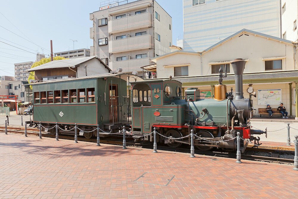 MATSUYAMA JAPAN - Botchan train near Dogo Onsen station in Matsuyama Japan. Botchan Ressha is a diesel-powered replica of a German small-gauge steam locomotive installed in 1888