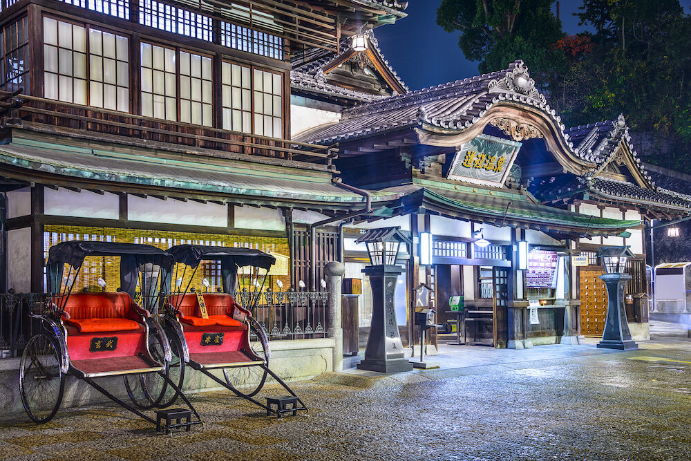 MATSUYAMA, JAPAN - Dogo Onsen bath house entrance at night. It is one of the oldest and most celebrated bath houses in the country.