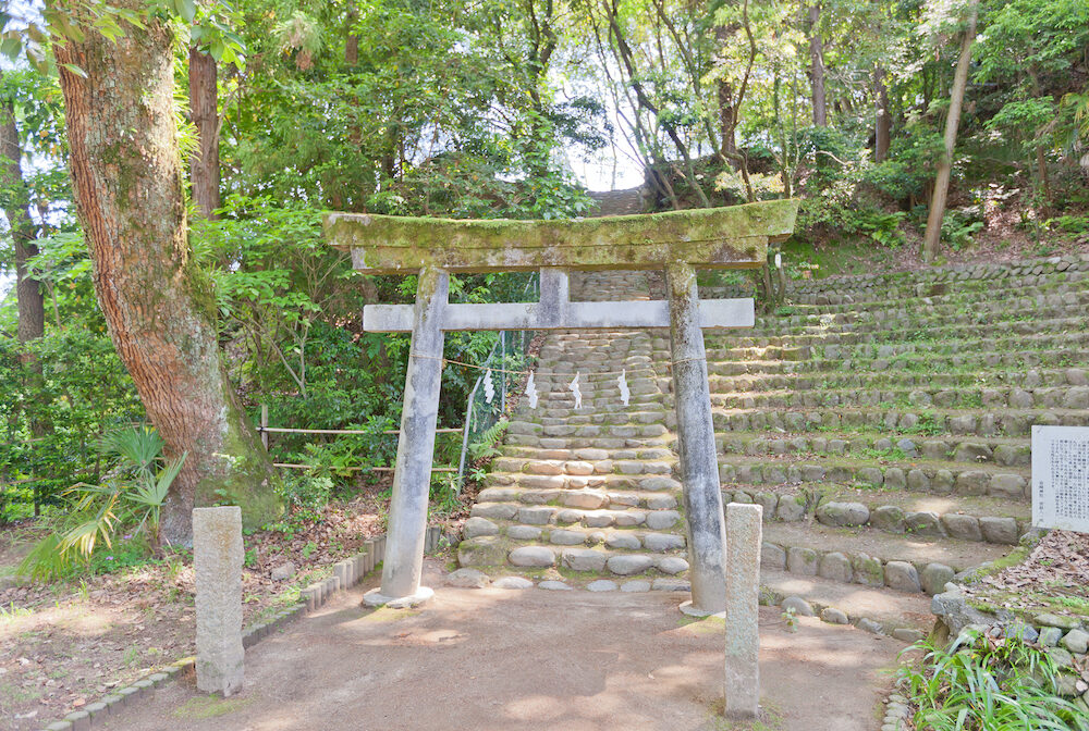 MATSUYAMA JAPAN - Torii gate of Iwasaki Shinto Shrine in Dogo Park of Matsuyama city Shikoku Island Japan. Located on grounds of former Yuzuki castle