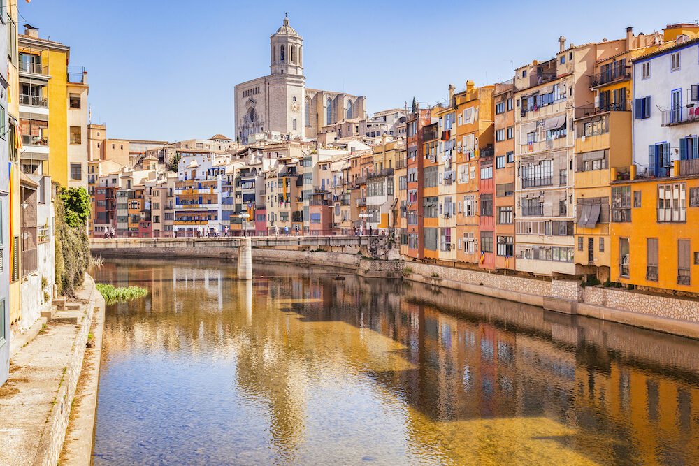 Girona, Catalonia, Spain - Medieval houses on the banks of the River Onyar, and the Cathedral of Saint Mary of Girona
