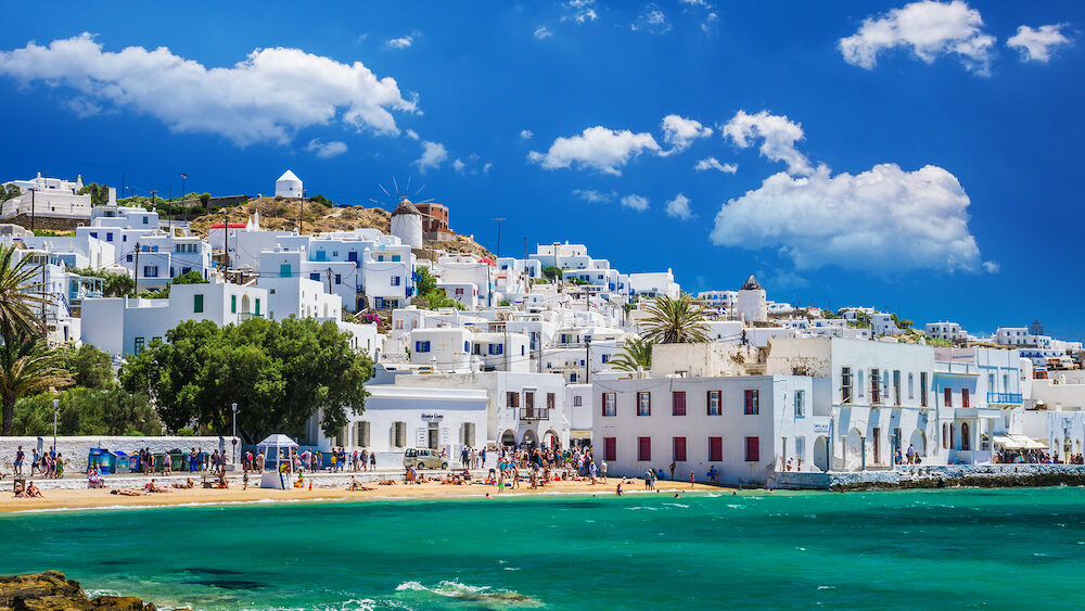 MYKONOS, GREECE - Beautiful view of Mykonos town in Cyclades Islands. There are white houses and boats in the old harbour.