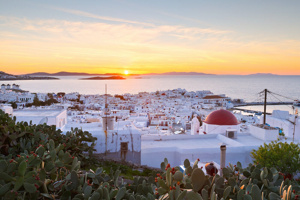 View of Mykonos town and Syros island in the distance, Greece.