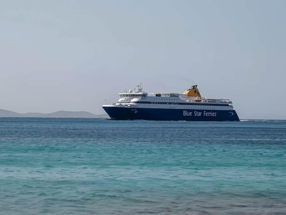 MYKONOS, GREECE- a blue star ferry arrives at the island of mykonos