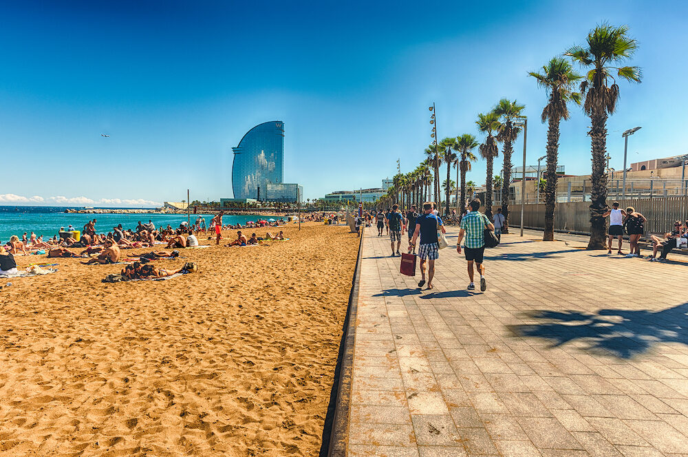 BARCELONA : People enjoying a sunny day on La Barceloneta beach Barcelona Catalonia Spain