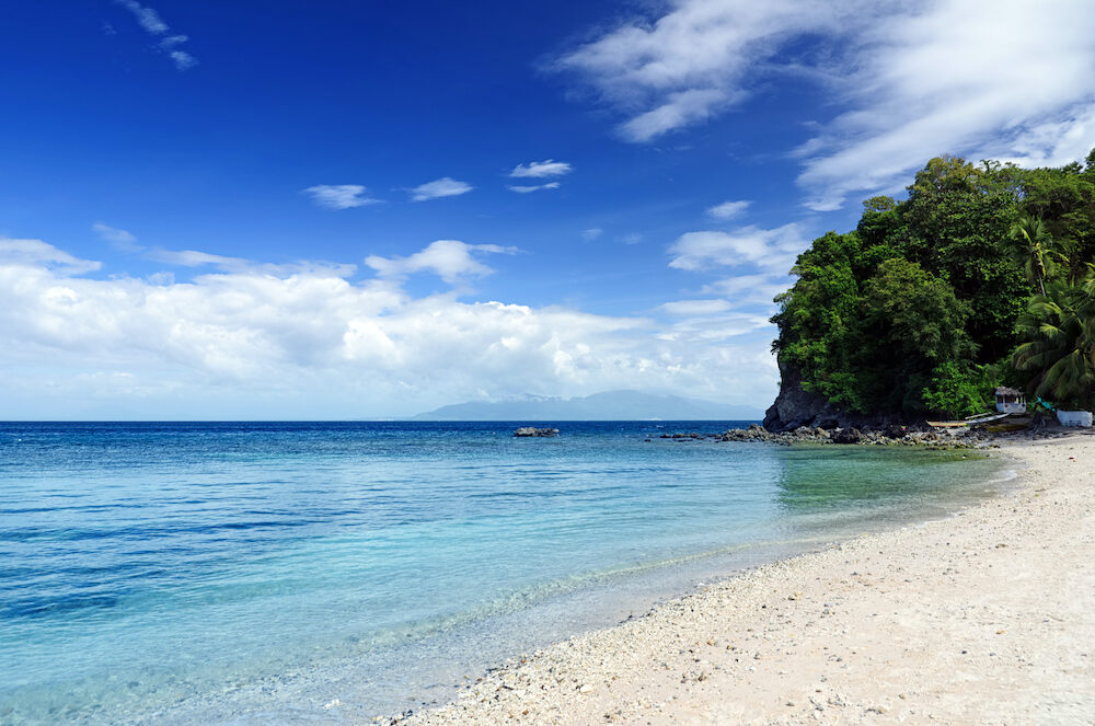 Blue sky and clear water. The White Beach Puerta Galera Philippines.