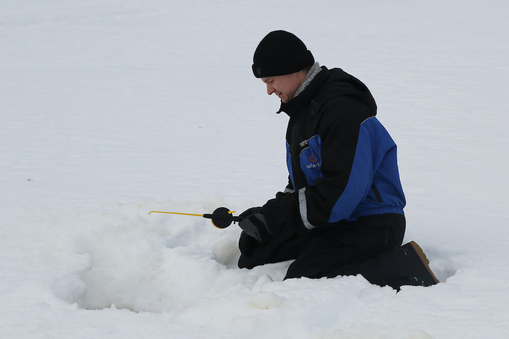ROVANIEMI, FINLAND - Unidentified fisherman during ice fishing on the frozen lake in Lapland, Finland