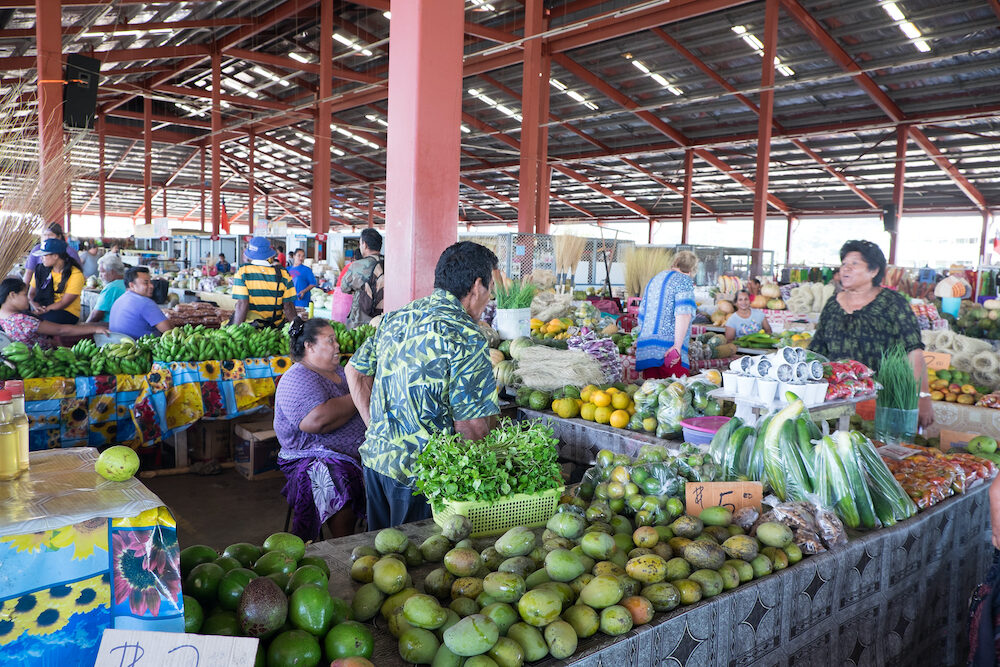 Apia, Samoa - customer and stallholders talking at Fugalei fresh produce market