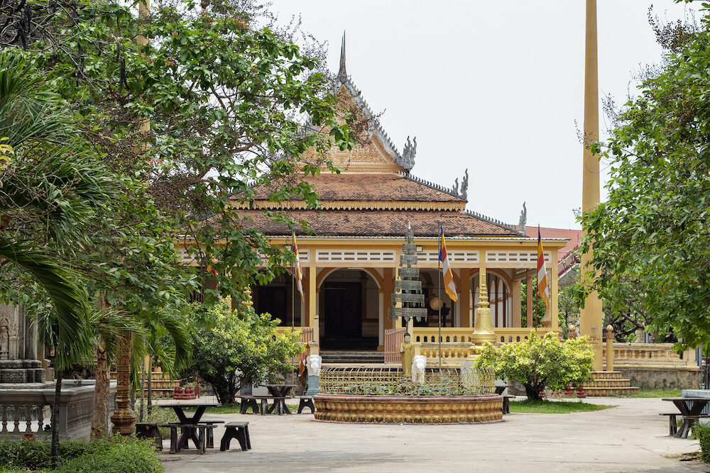 Buddhist architecture in Wat Damnak pagoda, Siem Reap, Cambodia. Traditional thai or khmer pagoda. Buddhist shrine with ornament. Roof gable ending. Buddhist wat and park. Cambodian sightseeing travel