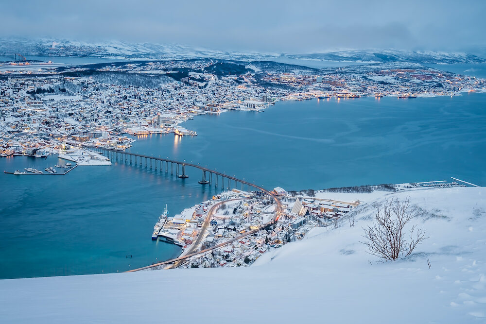 Aerial view to the city of Tromso in winter from the mountain ledge Storsteinen, 421 m above sea level , Northern Norway