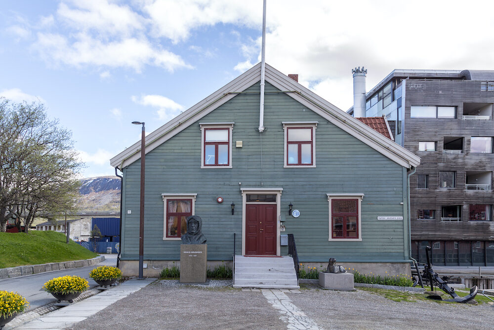 Tromso, Norway - Exterior view of the Polar Museum with a Roald Amundsen statue