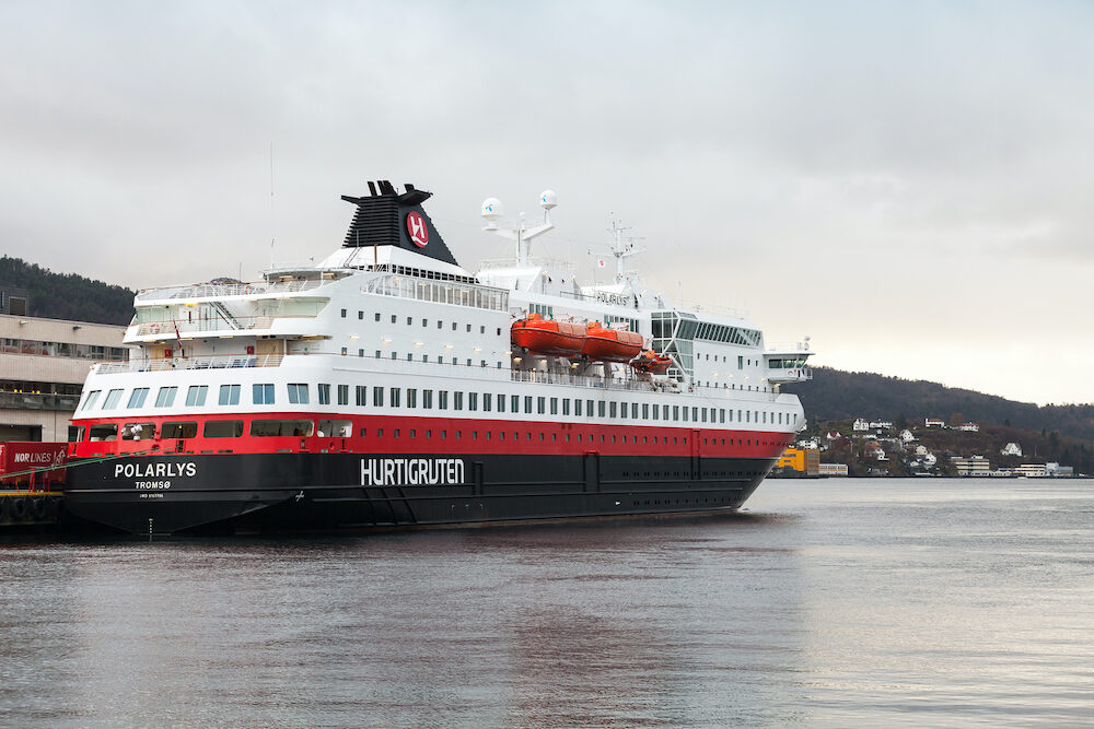 Bergen, Norway - Passenger ferry Polarlys operated by Hurtigruten stands moored in port of Trondheim, stern view
