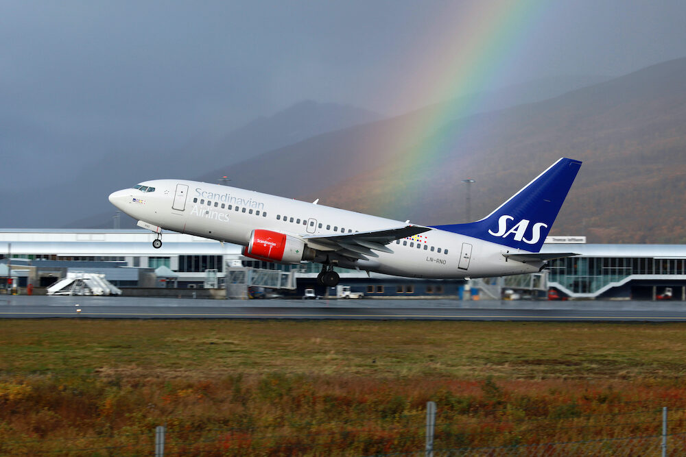 TROMSO NORWAY - A SAS Scandinavian Airlines Boeing 737 takes off on September 21 2012 in Tromso Norway. SAS operates with 152 aircraft and carried 22.9 million passengers in 2011.