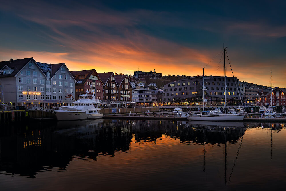 Tromso, Norway - View of the sunset over the Tromso harbor. Tromso lies in Northern Norway, north of the Arctic Circle