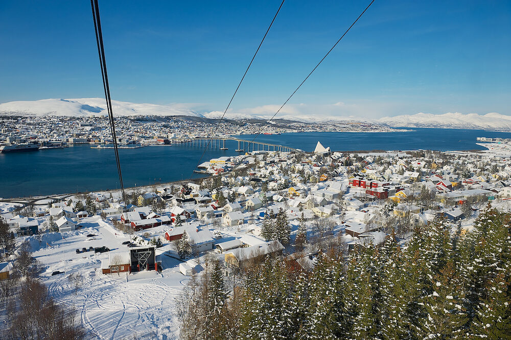 TROMSO, NORWAY - View to the Tromso city from the Fjellheisen aerial tramway cabin in Tromso, Norway.