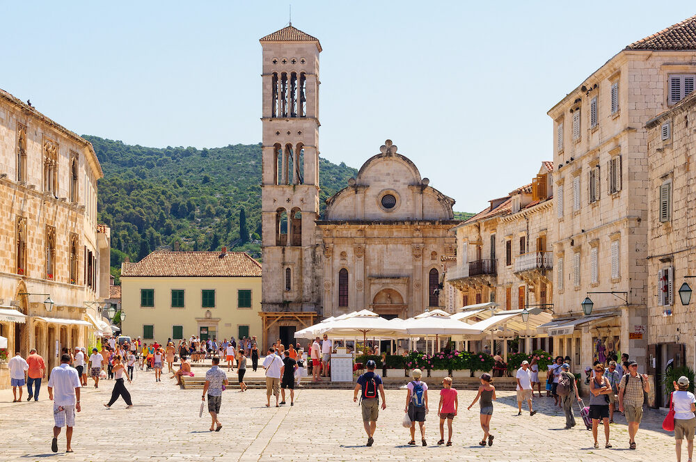 Tourists on the Main Square in front of the Roman Catholic cathedral of St. Stephen - Hvar, Croatia