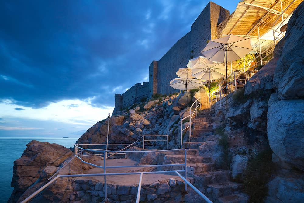 DUBROVNIK, CROATIA - Buza beach cafe at night. It is one of the most beautiful bars in Dubrovnik which is hanged on the cliffs right above the sea, with an amazing view of the Adriatic.