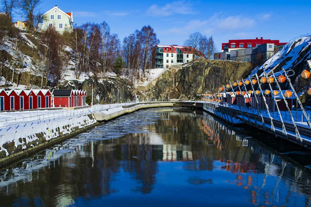 Gothenburg / Sweden - Lindholmen dock in the winter. Red boathouses surrounding the small marina.