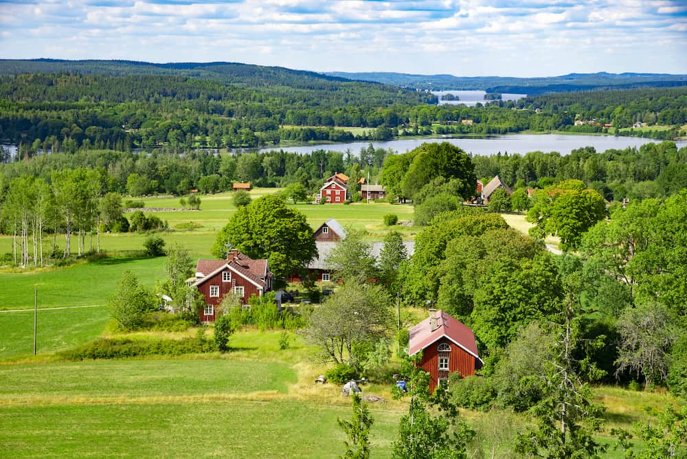 Rural view of villages near lakes with pretty wooded boundaries, in the beautiful surroundings. Swedish countryside