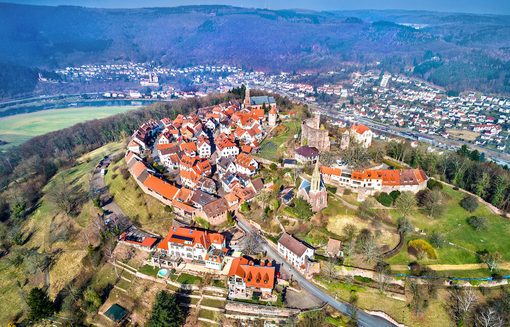 Aerial view of Dilsberg, a town with a castle on the top of a hill surrounded by a Neckar river loop. Germany, Baden-Wurttemberg
