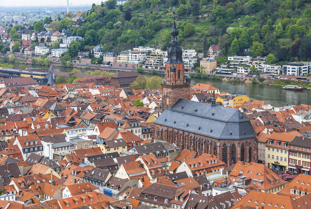 Aerial view of Heidelberg city Baden-Wurttemberg state Germany. Old town (Altstadt) and Church of the Holy Spirit (Heiliggeistkirche) on a foreground. View from Heidelberg Castle