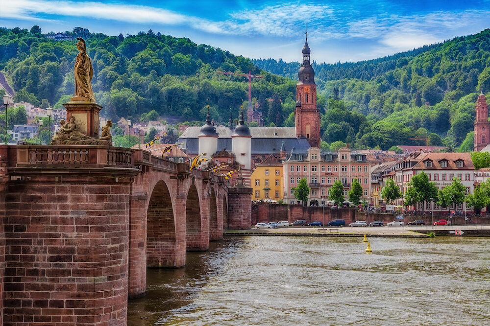 Heidelberg with a view of the old town with old bridge over the river Neckar and Holy Spirit Church.