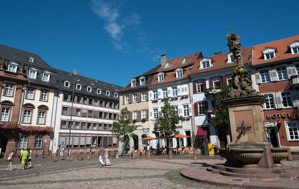 Heidelberg Germany - Tourists walking in the famous Marktplatz or Market Square in the old historical town of Heidelberg in Germany