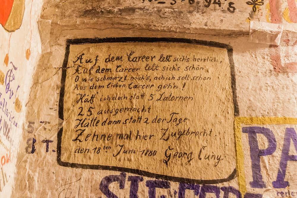 HEIDELBERG, GERMANY - Wall inscriptions in the old Studentenkarzer Student Jail in Heidelberg.