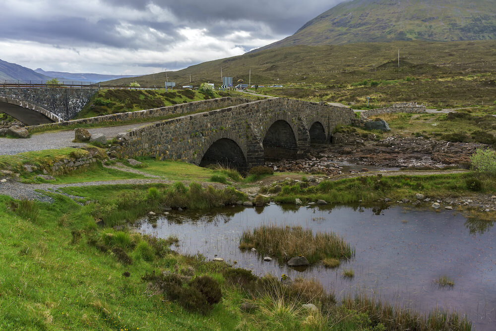 An old Sligachan bridge situated at the junction of the roads from Portree, Dunvegan and Broadford , provides a good viewpoint for seeing the Black Cuillin mountains , Isle of Skye, Scotland