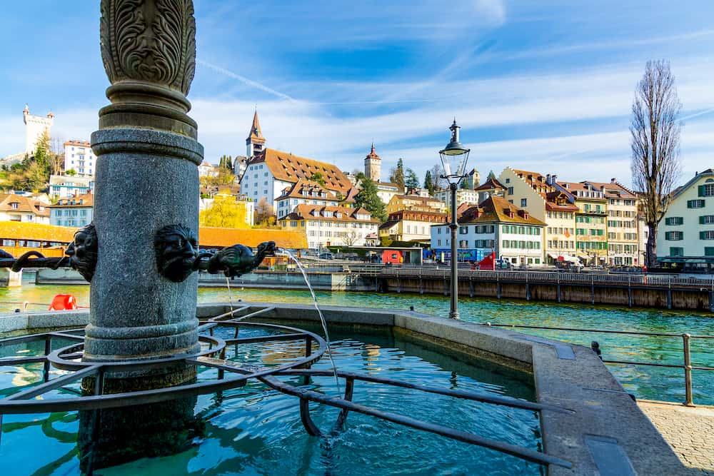 Old town fountain over the Reuss river in Lucerne old Town, Switzerland