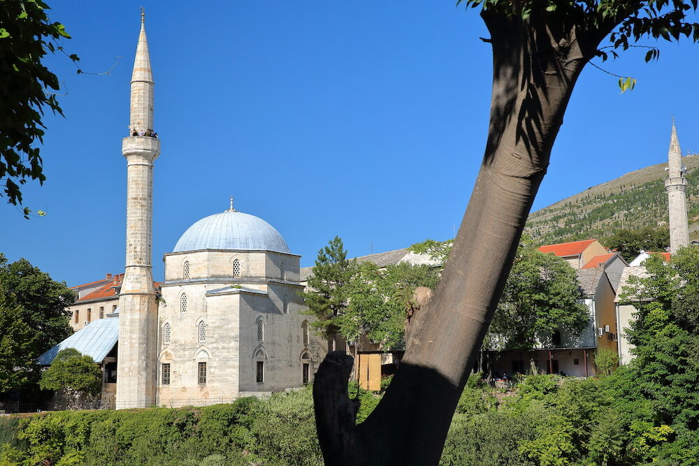 Koski Mehmed Pasha Mosque, located along the Neretva river, with the minaret of Nesuh Aga Vucjakovic Mosque on the right, Mostar, Bosnia and Herzegovina
