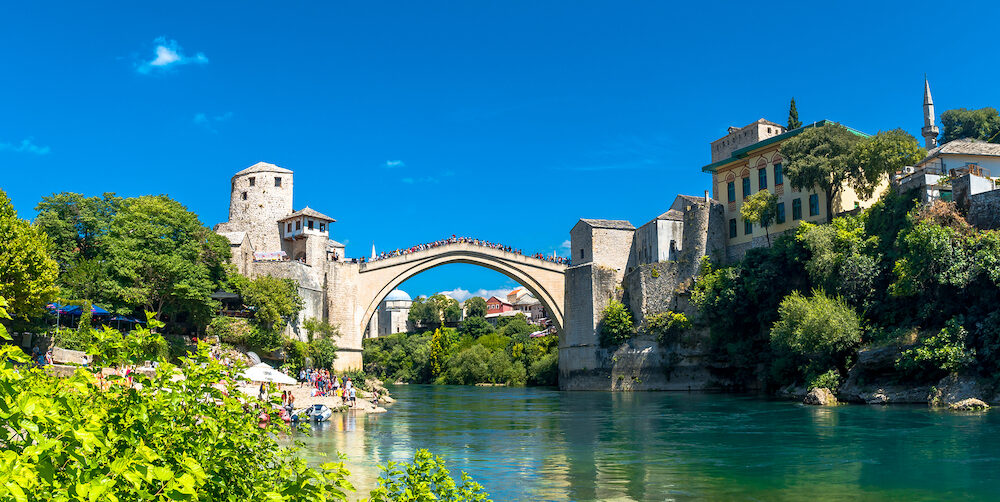 MOSTAR, BOSNIA - Panoramic view of Old Mostar Bridge on Neretva River from observation tower. Mostar is one of the most famous place of Balkans.