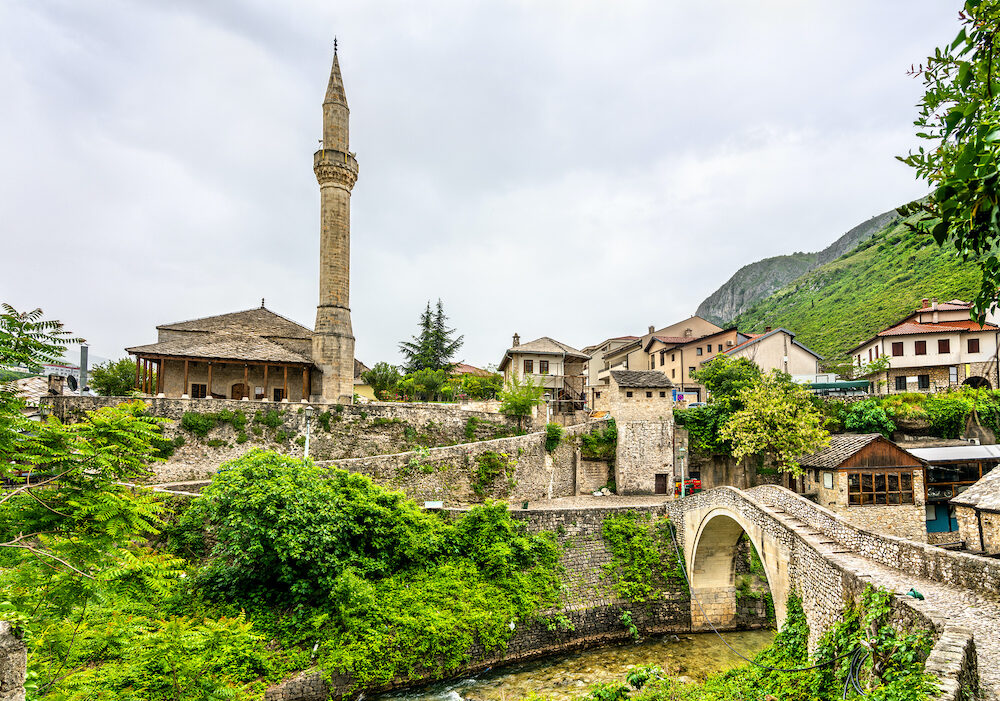 View of Nezir Agina Mosque and Crooked bridge in Mostar, Bosnia and Herzegovina