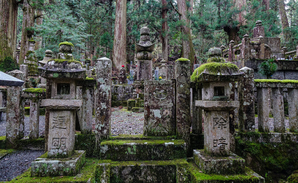 Koyasan, Japan - Ancient graves at forest in Mount Koya, Japan. Koyasan is primarily known as the world headquarters of the Shingon sect of Buddhism.
