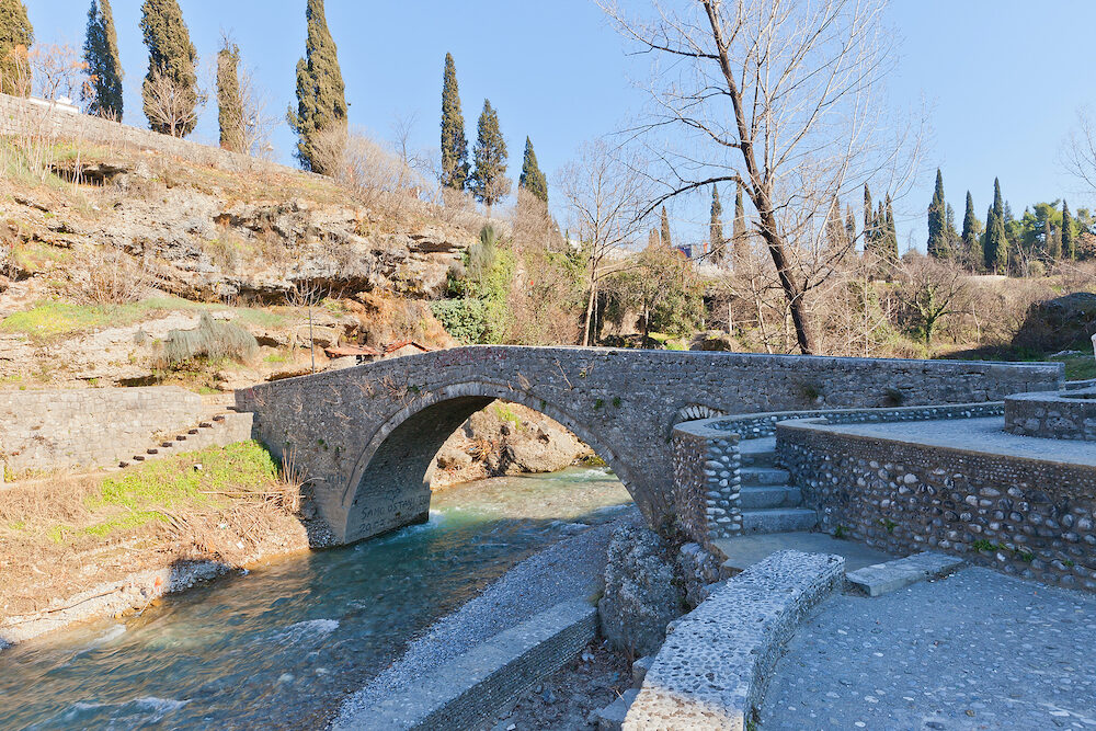 PODGORICA MONTENEGRO - Old stone arch bridge on Sastavci over Ribnica River in Podgorica Montenegro. Popular hangout of lovers gathering place of young