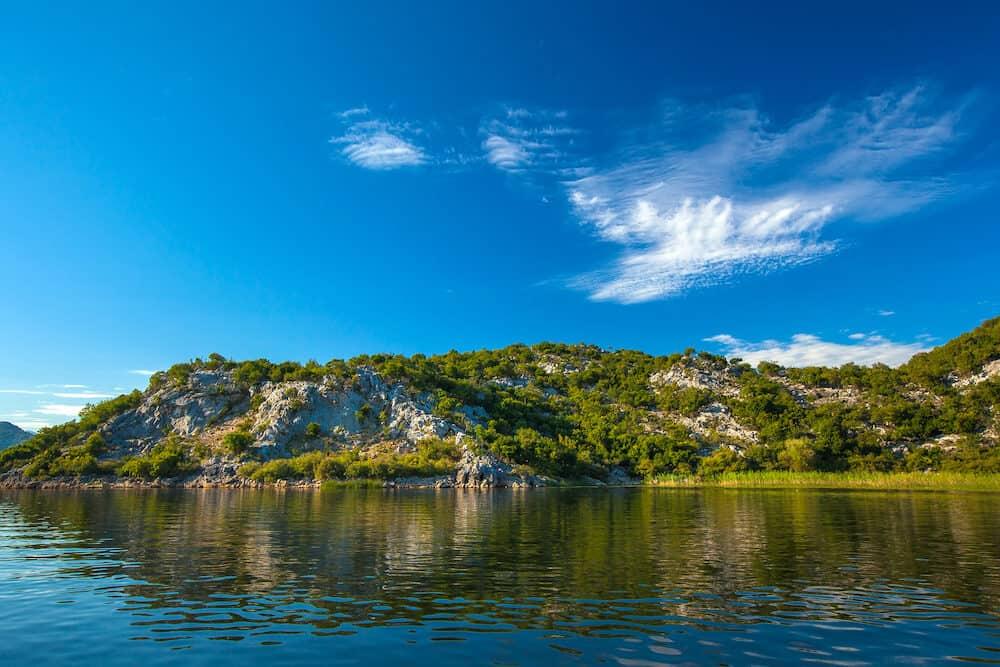 Slope of a rocky mountain with trees on the Skadar Lake. Montenegro. Photo taken at Skadar Lake Podgorica region.