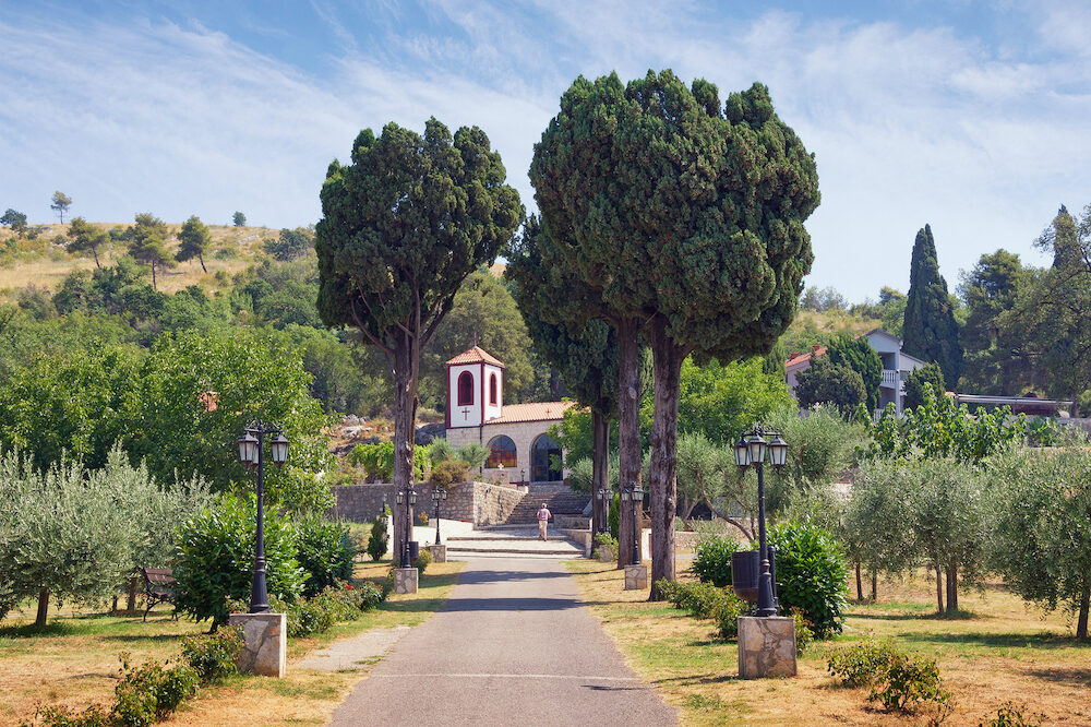 Road to the temple. View of Serb Orthodox Christian Monastery of Dajbabe. Podgorica, Montenegro