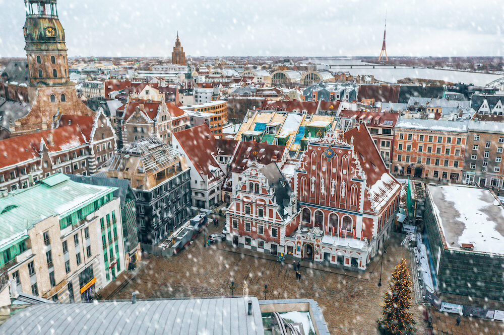 Riga, Latvia. Aerial view of the roofs of the old town with the tower of the Dome Cathedral and the House of the Blackheads during winter season in Riga. Latvia.