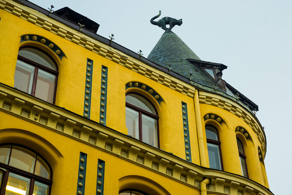 Cat statue on the roof. Detail of Cat House in the center of Riga, Latvia