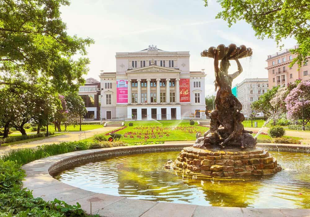Riga, Latvia. Latvian National Opera building , park and fountain in the Latvian capital Riga