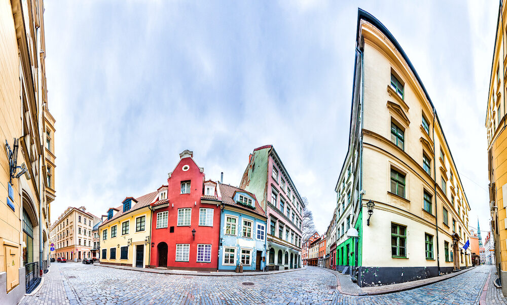 Streets of Riga Old Town with colourful houses, Latvia. 360 degree panoramic montage