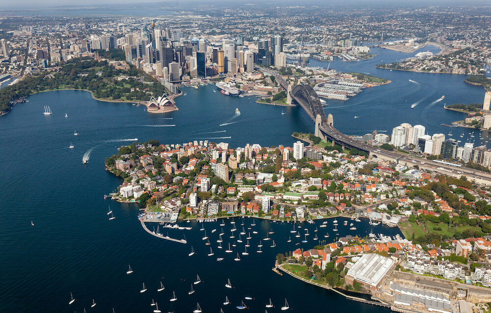 Aerial view from helicopter of Sydney CBD featuring the harbour - Kirribilli - harbour bridge. Sydney NSW Australia