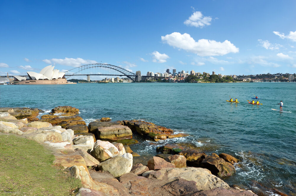 Sydney Harbour skyline with the Sydney Harbour Bridge and the Opera House in New South Wales Australia.