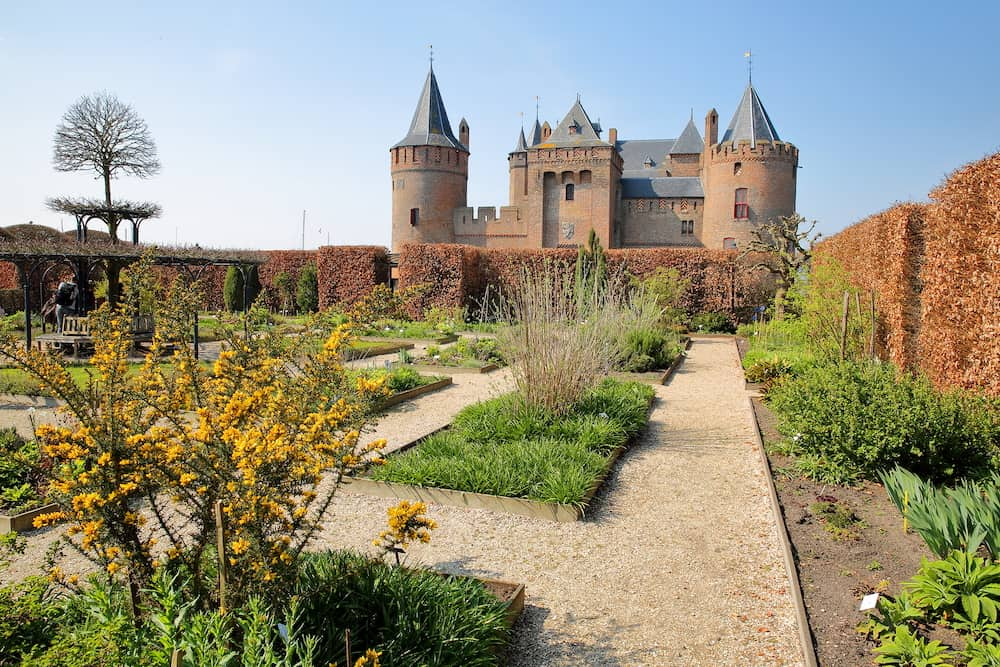 MUIDEN, NETHERLANDS Muiderslot Castle, a medieval castle, with the gardens and spring colors