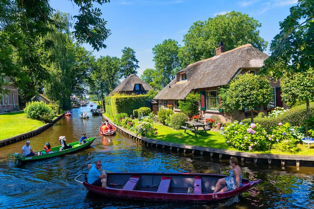 Giethoorn, Netherlands - view of famous village Giethoorn with canals in the Netherlands. Giethoorn is also called 'Venice of The Netherlands'