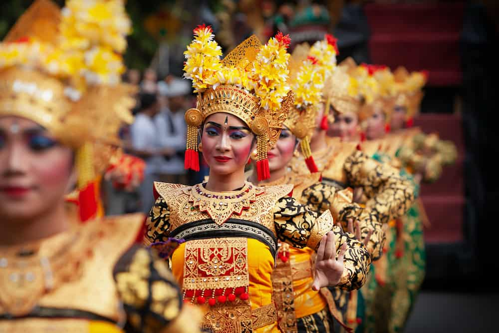DENPASAR, BALI ISLAND, INDONESIA - : Face portrait of beautiful young Balinese women in ethnic dancer costume, dancing traditional temple dance Legong at art and culture festival parade.