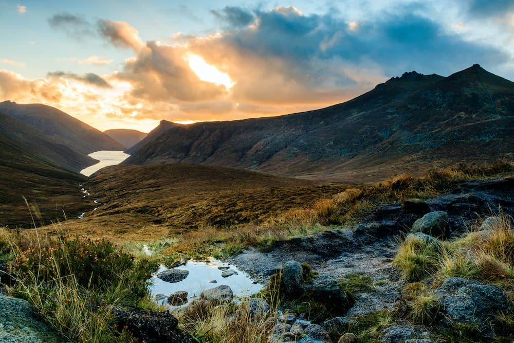 Ben Crom Reservoir in the Mourne Mountains, County Down, Northern Ireland, seen at sunset