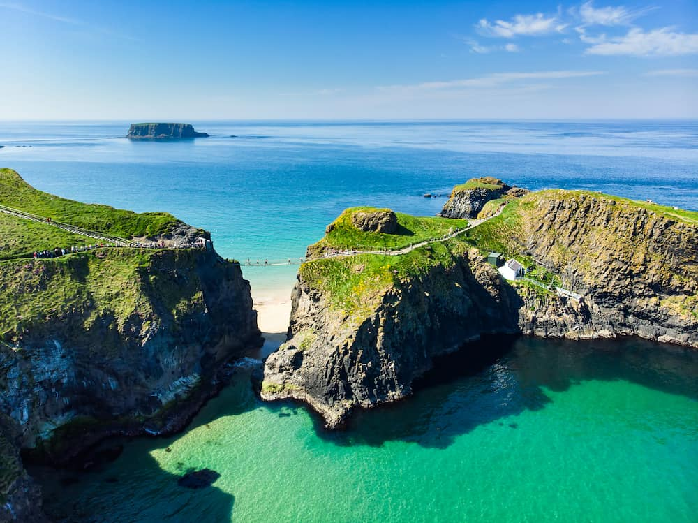 Carrick-a-Rede Rope Bridge, famous rope bridge near Ballintoy in County Antrim, linking the mainland to the tiny island of Carrickarede. One of the most iconic tourist attractions in Nothern Ireland.